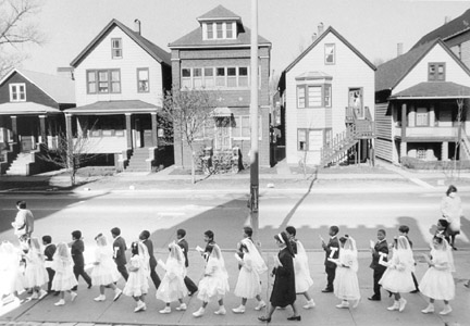 A Group of First Holy Communion Pass the St. Michaels Rectory on Their Way to Church, May 1, 1987, from Changing Chicago