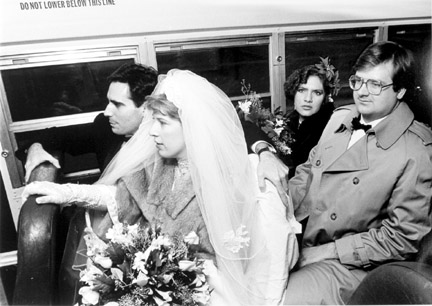 Michael and Maryann Shiffer Aboard a Bus That Will Take Them to the Train Station