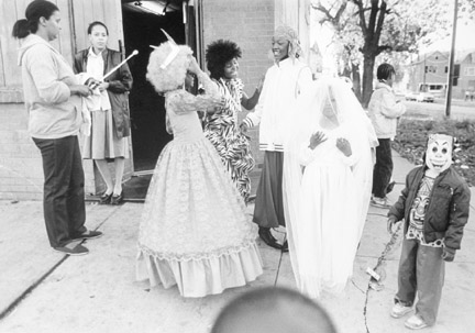 91st Buffalo Avenue. Kids and Their Parents Wait Outside a Community Club House for a Halloween Party, October 31, 1987