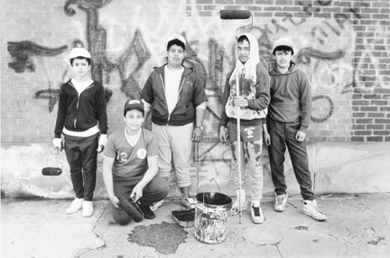 A Group of Young Men Volunteer Their Time to Clean Up the Gang Graffiti From Buildings and Churches, April 16, 1988