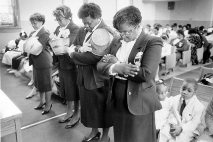 Women Worshippers After Helping in the Collection Bow Their Heads in Prayer, April 3, 1988