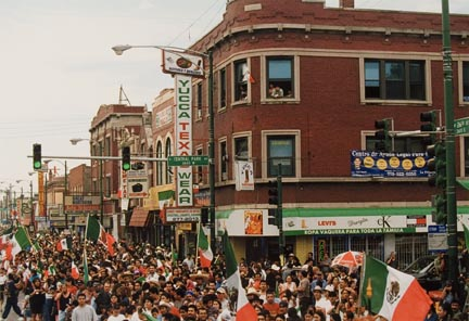 Thousands of Spectators Wave Flags and Cheer During the Annual Mexican Independence Parade Down 26th Street in Chicago's Neighborhood of Little Village, September 1994
