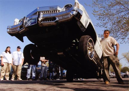 Pete Hernandez Straightens the Wheels of his Chevrolet as his Car Hops Nearly 35 Inches Off the Street at La Baugh Woods Near Foster and Cicero in Chicago, May 2003