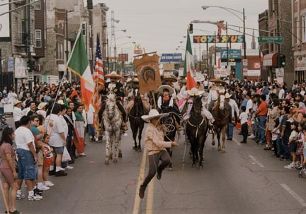 A Young Cowboy Performs Rodeo Rope Tricks as he Marches West on Cermak, During the Annual Cinco de Mayo Parade, May 1996