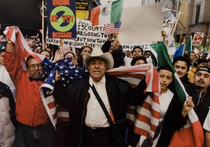 Roberto Cardenas, Center, and Fellow Demonstrators Carry Flags and Signs as they March Along Adams Street in the Loop to Federal Plaza, March 10, 2006