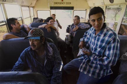 Farm Workers Take a Break After Weeding a Basil Field, in Momence, Inside a Bus Used Both for Transportation and as a Resting Place Away from the Harsh Sun, July 2010