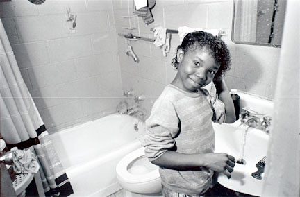 Young girl washing hair in sink, Cabrini-Green, from Changing Chicago