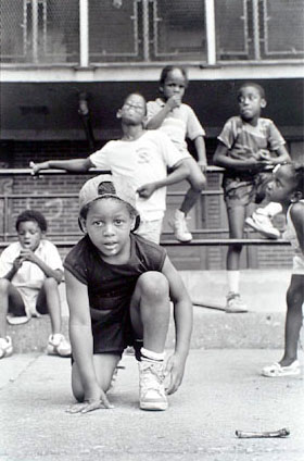 Kids playing outside, 929 N Hudson, Cabrini-Green, from Changing Chicago