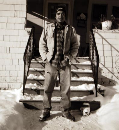 Untitled (man with snow in front of stairs)