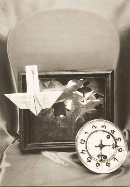 Untitled (clock and paper plane)