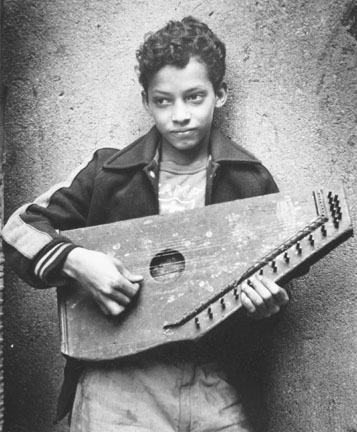 Boy with Zither, 105th Street, New York