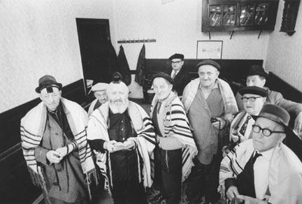 "Early morning Minyen - (left to right) Mesrs. Beer, Klugsman, Rabbi Tirnauer, Lehrer, . Ginzer, Samstag, Schonblum, and Samstag senior., from the ""The Last Jews of Radauti"" series"