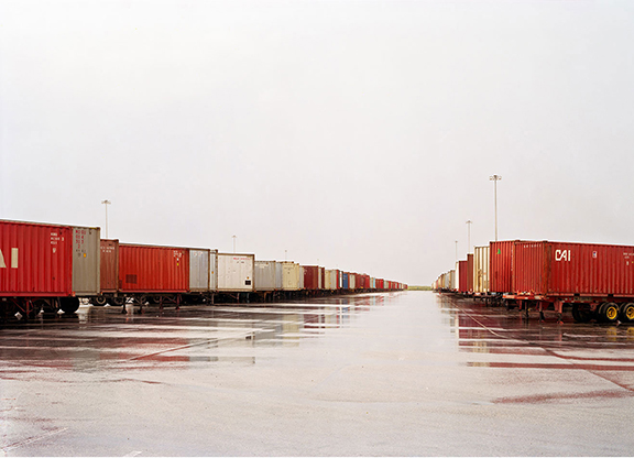 Untitled (red containers, wet ground), Fort Worth, Texas