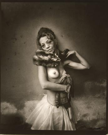 Untitled (woman in tutu and fox collar holding rag doll)