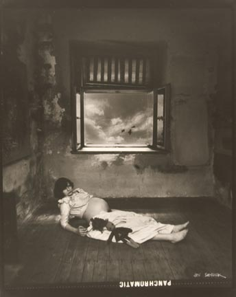Untitled (pregnant woman lying on floor with doll)