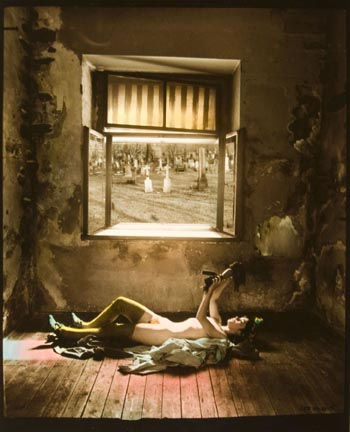 From Cradle to Grave (girl laying on floor with doll, cemetery in window)