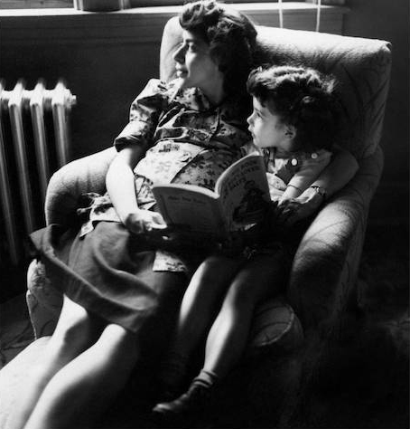 In her doctor's office in Chicago, in 1951, Florence, pregnant with our second child, Harmon, waits with early bibliophile Jane, age 5.