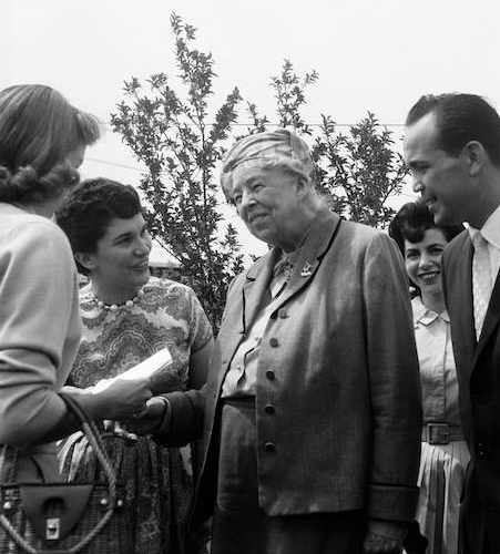 In racially turbulent 1961 Eleanor Roosevelt showed up in Deerfield to help the cause of African-Americans buying two $46,000 homes in a development spawned by an associate of Adlai Stevenson's law firm. Here, Mrs. FDR visited our fellow activists, the Berliants, and Florence- peeping through at the right, was on the greeting line, as was our 15 year old daughter, Jane. Mrs. Roosevelt's visit was a great booster for our cause.
