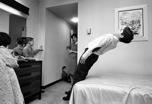 I was doing a magazine story on our suburban family spending a weekend in a downtown hotel during the Christmas season. The kids' favorite activities? Riding the elevators and calling room service. Here Harmon energetically tests a Sheraton mattress as we settle in.