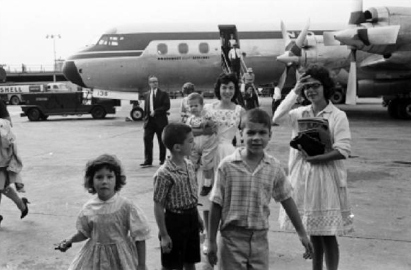 For long distance travel we preferred the airplane. Here, early in the Sixties we arrived at LaGuardia Field, to visit the kids' Brooklyn grandparents. Note the slow  propeller plane.