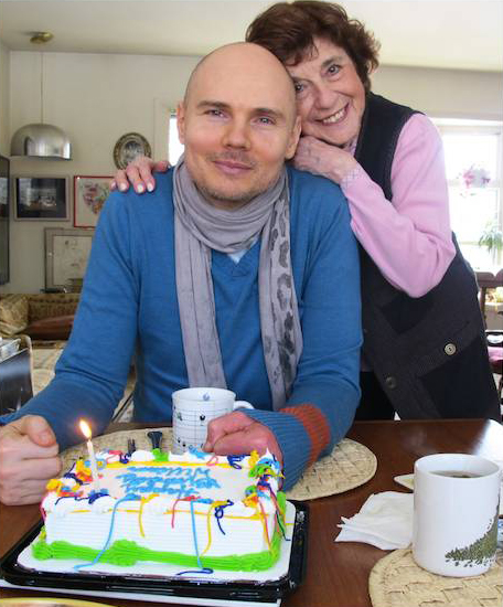 Florence was rock star Billy Corgan's guide to published poetry. He bought many poetry books from her and was often lost in deep, probably creative, thought, hanging around Titles' poetry shelves. Then, gradually availing himself of Florence's renowned good advice gene, Billy began to regard  her as his substitute Jewish mother. Here Florence surprised Billy with a birthday cake at one of our Sunday bagel and lox breakfasts. [...]