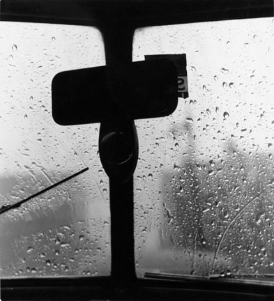 Untitled (Rearview mirror, wiper, rain covered windsheild)