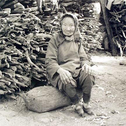 Wood Gatherer with Bound Feet Along the Burmuda Road