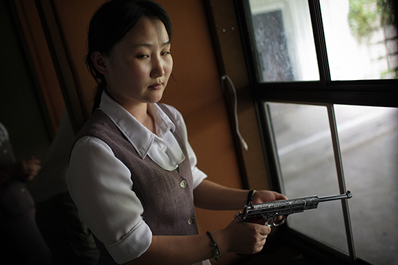 A North Korean woman loads a Pistol for firing practice in Pyongyang, North Korea on Aug. 18, 2007